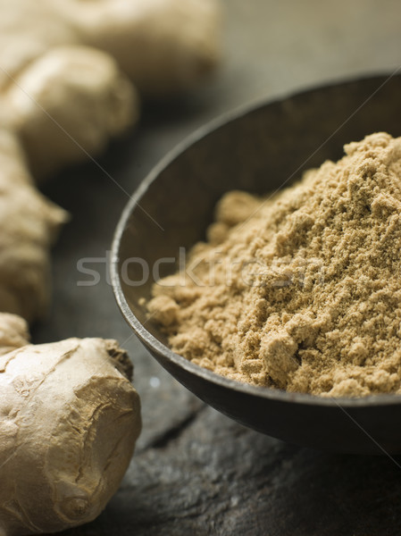 Dish of Ginger Powder with Fresh Ginger Root Stock photo © monkey_business