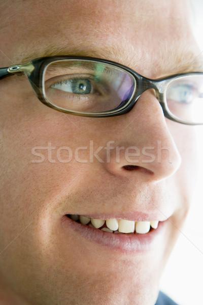 Сток-фото: голову · выстрел · человека · улыбаясь · очки · портрет