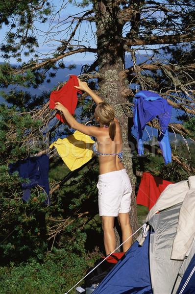 Fiatal nő akasztás ki mosás fa táborhely Stock fotó © monkey_business
