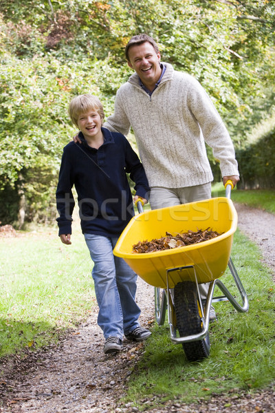 Father and son pushing wheelbarrow Stock photo © monkey_business