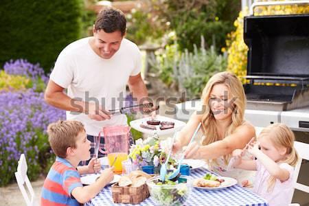 Család élvezi barbeque nő étel férfi Stock fotó © monkey_business