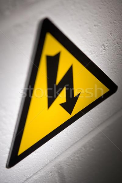 Hoogspanning teken macht elektriciteit Geel kleur Stockfoto © monkey_business