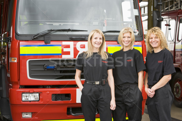 Portrait of firefighters standing by a fire engine Stock photo © monkey_business