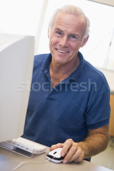 Mature male student learning computer skills Stock photo © monkey_business