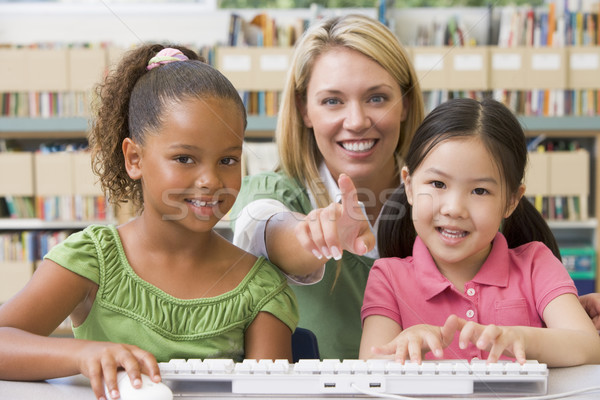 Kindergarten teacher sitting with children at computer  Stock photo © monkey_business