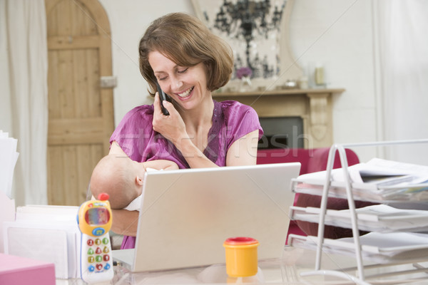 Mother and baby in home office with laptop and telephone Stock photo © monkey_business