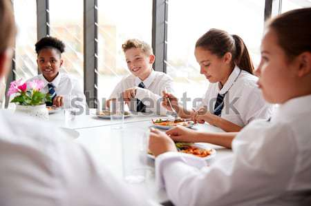 Middelbare school studenten eten school cafetaria student Stockfoto © monkey_business