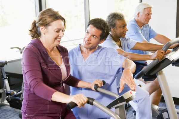 Nővér beteg rehabilitáció testmozgás gép nők Stock fotó © monkey_business