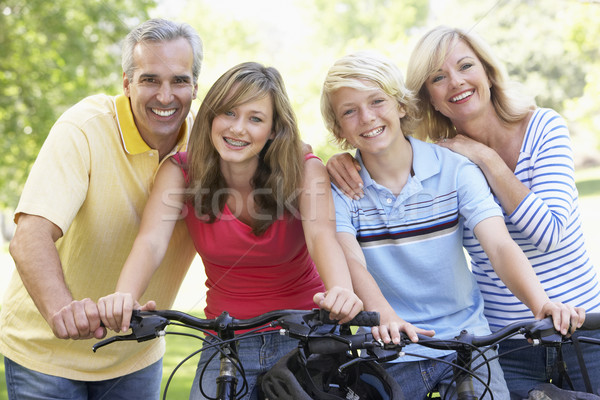 Family Cycling Through A Park Stock photo © monkey_business