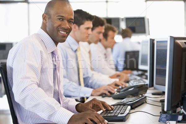 Stock munka üzlet boldog üzletember dolgozik Stock fotó © monkey_business