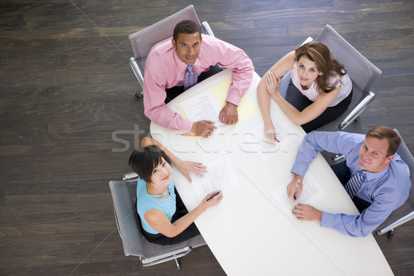 Four businesspeople at boardroom table Stock photo © monkey_business