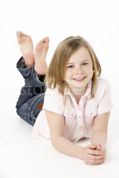 Young Girl Lying On Stomach In Studio Stock photo © monkey_business