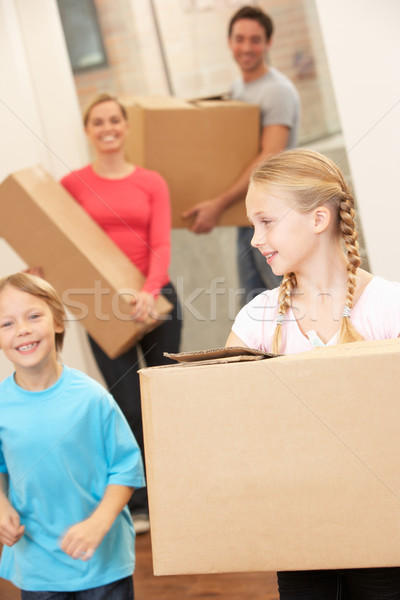 Stock photo: Family happy on moving day carrying cardboard boxes