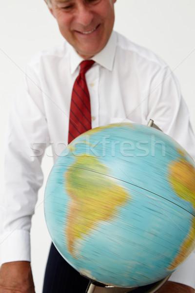 Senior empresário globo trabalhando mercado estúdio Foto stock © monkey_business