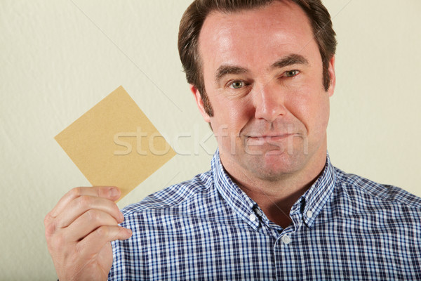 Studio Shot Of Middle Aged Man Holding Wage Packet Stock photo © monkey_business