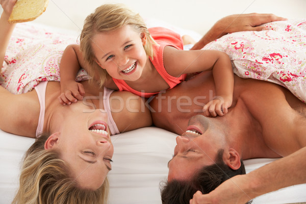 Family Relaxing Together In Bed Stock photo © monkey_business
