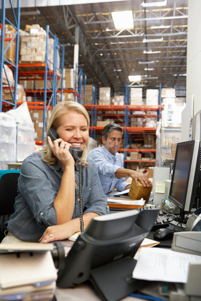 Businesswoman Working At Desk In Warehouse Stock photo © monkey_business
