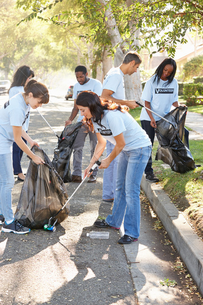Team Of Volunteers Picking Up Litter In Suburban Street Stock photo © monkey_business