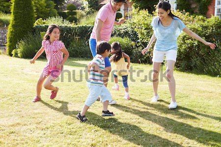 Grandparents And Grandchildren Having Picnic On Riverbank Stock photo © monkey_business