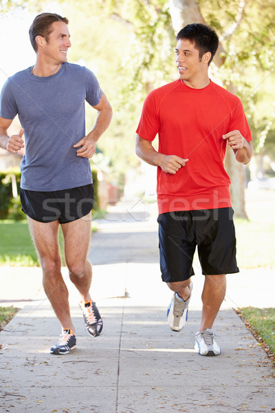 Two Male Runners Exercising On Suburban Street Stock photo © monkey_business