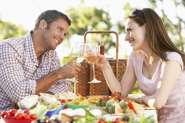 Couple Eating An Al Fresco Meal, Toasting With Wineglasses Stock photo © monkey_business