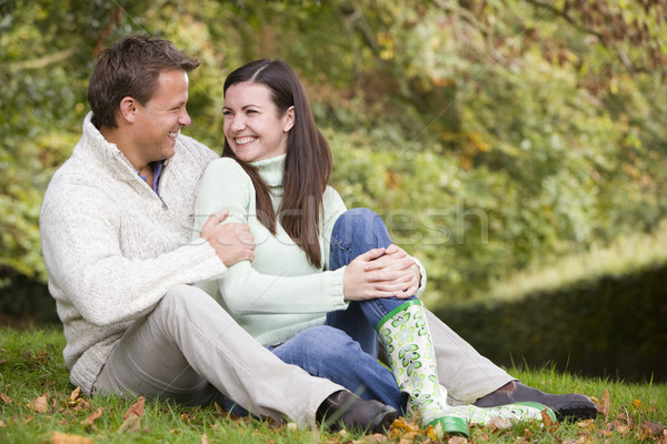Couple relaxing in autumn woods Stock photo © monkey_business