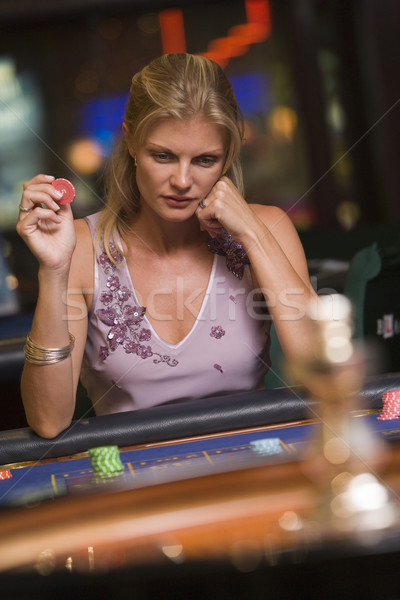 Woman losing at roulette table Stock photo © monkey_business