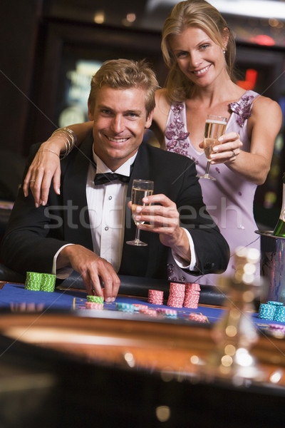 Couple gambling at roulette table Stock photo © monkey_business