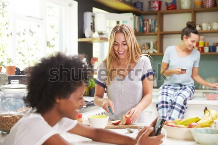 Stock photo: Two women at party putting candles in cake smiling