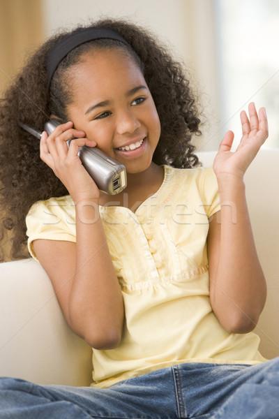 Сток-фото: гостиной · телефон · улыбаясь · детей · телефон