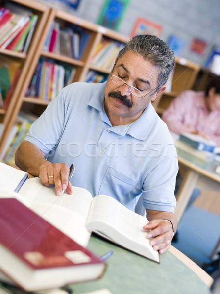 Mature male student studying in library Stock photo © monkey_business