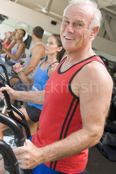 Stock photo: Man Running On Treadmill At Gym