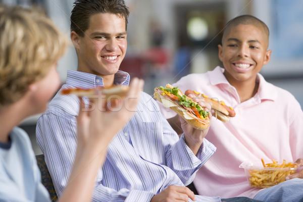 Ragazzi adolescenti fast food insieme alimentare pizza Foto d'archivio © monkey_business