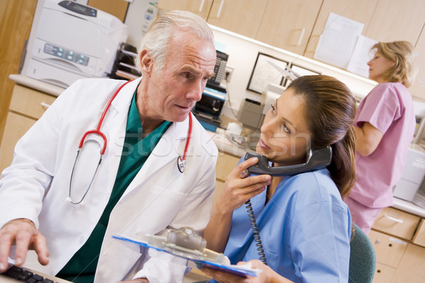 Lekarza pielęgniarki recepcji szpitala człowiek kobiet Zdjęcia stock © monkey_business