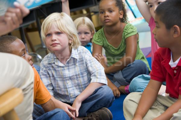 Kindergarten children listening to a story Stock photo © monkey_business