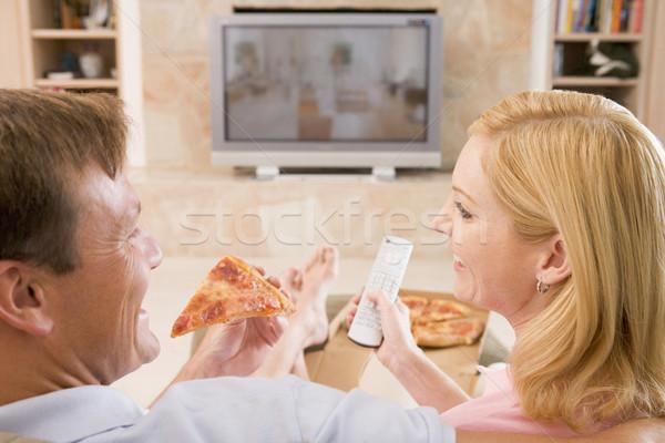 Coppia pizza tv televisione lounge Foto d'archivio © monkey_business