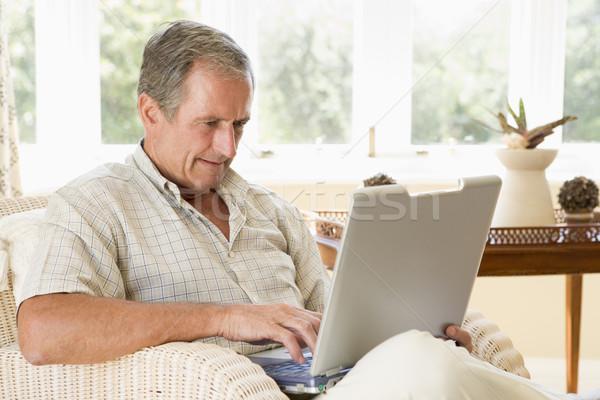 Férfi nappali laptop boldog technológia kanapé Stock fotó © monkey_business