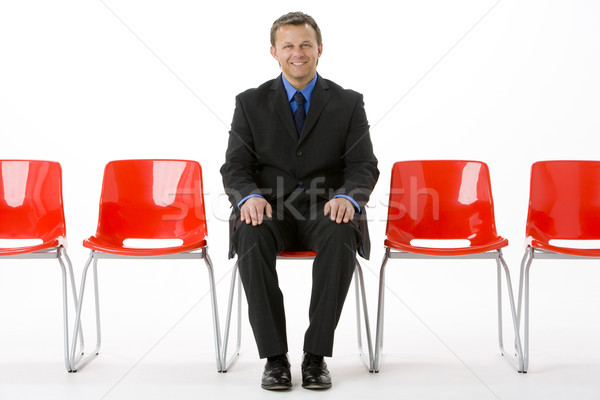 Businessman Sitting In Row Of Empty Chairs  Stock photo © monkey_business