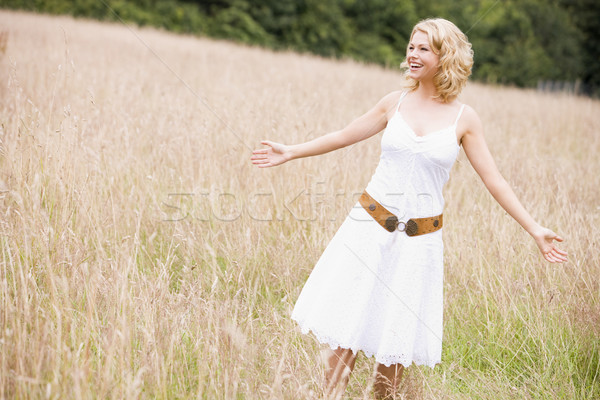 Stock photo: Woman standing outdoors smiling