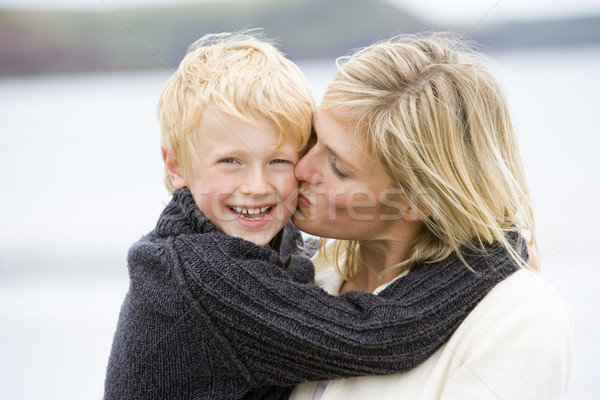 Mother kissing son at beach smiling Stock photo © monkey_business