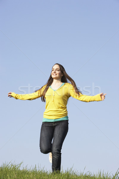 Teenage Girl Running Through Summer Meadow Stock photo © monkey_business