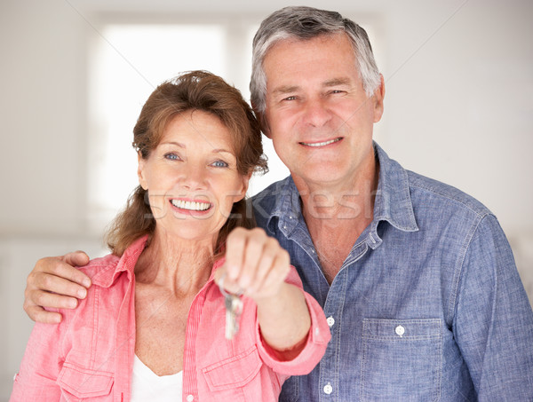 Stock photo: Senior couple moving into new home