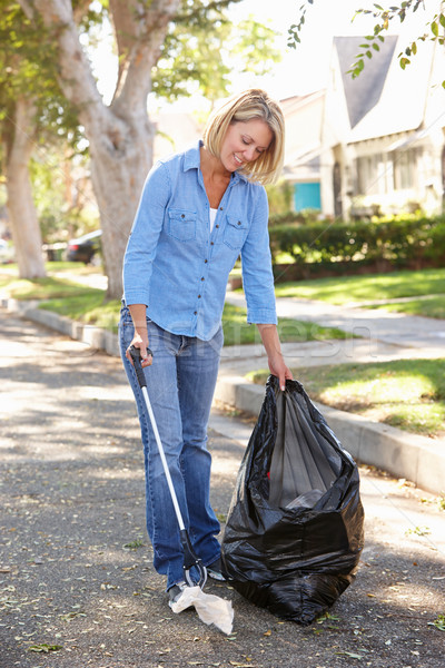 Woman Picking Up Litter In Suburban Street Stock photo © monkey_business
