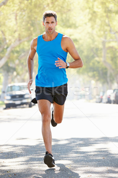 Homme coureur banlieue rue route Photo stock © monkey_business