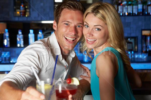 Pár élvezi koktél bár üveg ital Stock fotó © monkey_business
