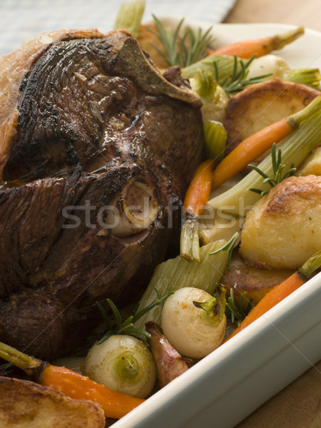 Roast Leg of Spring Lamb With Roast Potatoes and Vegetables Stock photo © monkey_business