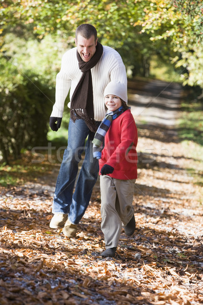 Father and son running along woodland path Stock photo © monkey_business