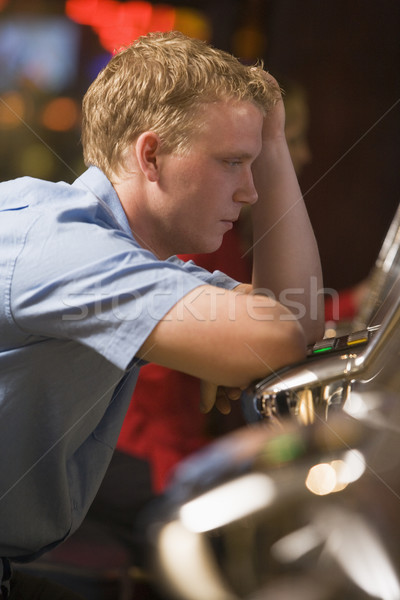 Man losing at slot machines Stock photo © monkey_business