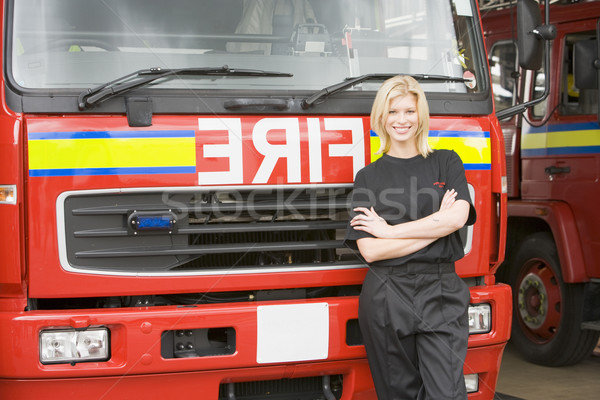 Portrait of a firefighter standing by a fire engine Stock photo © monkey_business