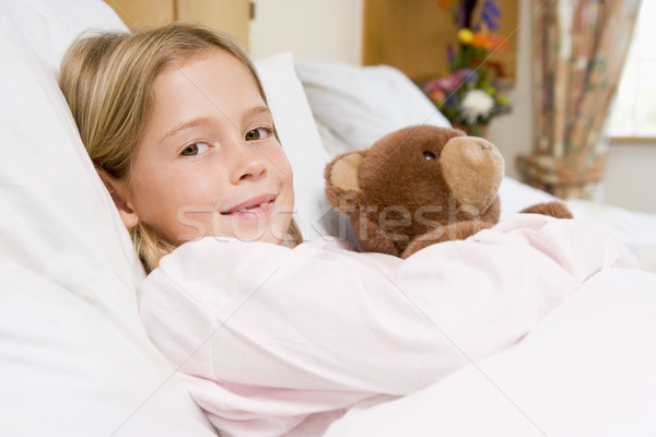 Stock photo: Young Girl Lying In Hospital Bed,Holding Teddy Bear